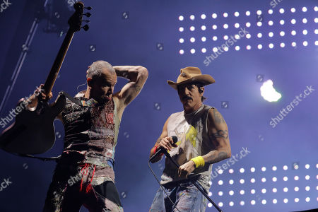 Anthony Kiedis, right, and bass player Flea of the band Red Hot Chili Peppers perform during the Rock in Rio music festival in Rio de Janeiro, Brazil, early