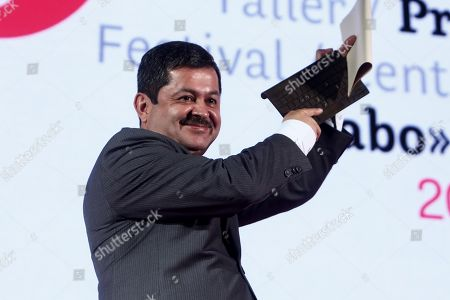 Colombian editor Luis Enrique Rodriguez celebrates after receiving the Clemente Manuel Zabala award for an exemplary editor during the awards ceremony at the VII Gabo Festival, in Medellin, Colombia, 03 October 2019. The award recognizes Ibero-America's best journalism.