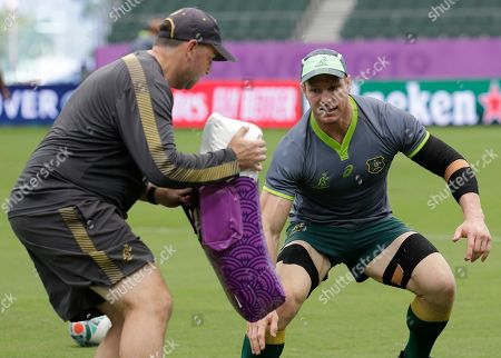 Australia rugby player David Pocock, right, trains at the Oita Stadium during the Rugby World Cup in Oita, southern Japan on . Australia will play a game against Uruguay tomorrow during their pool D match