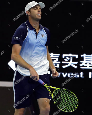 Sam Querrey of the United States reacts while competing against Alexander Zverev of Germany in their quarterfinal match in the China Open tennis tournament in Beijing