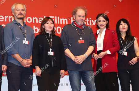 Mike Figgis (C), head of the jury for the New Currents competition section of the 24th Busan International Film Festival (BIFF), and other jurors pose during a news conference in the southeastern port city of Busan, South Korea, 04 October 2019. The five-member jury will select the two best feature films by up-and-coming Asian directors.