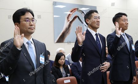 South Korea's head of Facebook Jung Ki-hyun (L), Google Korea CEO John Lee (C) and Apple Korea chief Brandon Yoon (R) take an oath during a parliamentary inspection of the Korea Communications Commission at the National Assembly in Seoul, South Korea, 04 October 2019.
