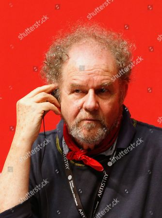 Stock Image of British director and competition jury head Mike Figgis attends a press conference for the New Currents section jury during the 24th Busan International Film Festival (BIFF) at the Shinsegae Department Centum City Culture Hall, in Busan, South Korea, 04 October 2019. The BIFF will screen 303 films from 85 countries and run from 03 to 12 October 2019.