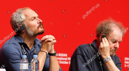 Czech artistic director of the Karlovy Vary Film Festival and competition jury member Karel Och (L) and British director and competition jury head Mike Figgis (R) attend a press conference for the New Currents section jury during the 24th Busan International Film Festival (BIFF) at the Shinsegae Department Centum City Culture Hall, in Busan, South Korea, 04 October 2019. The BIFF will screen 303 films from 85 countries and run from 03 to 12 October 2019.
