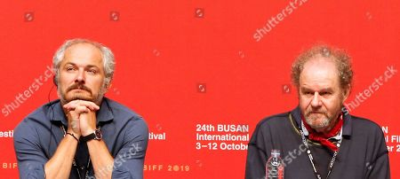Stock Picture of Czech artistic director of the Karlovy Vary Film Festival and competition jury member Karel Och (L) and British director and competition jury head Mike Figgis (R) attend a press conference for the New Currents section jury during the 24th Busan International Film Festival (BIFF) at the Shinsegae Department Centum City Culture Hall, in Busan, South Korea, 04 October 2019. The BIFF will screen 303 films from 85 countries and run from 03 to 12 October 2019.