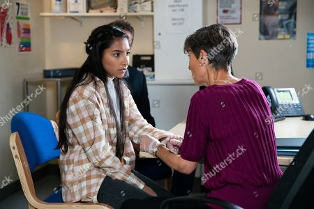 Stock Image of Ep 9893 Monday 7th October 2019 - 1st Ep Dev Alahan, as played by Jimmi Harkishin, takes Asha Alahan, as played by Tanisha Gorey, to see Dr Gaddas who assesses her sore arms and suggests counselling is the way forward.