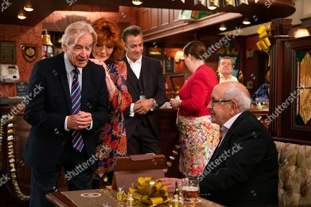 Stock Photo of Ep 9895 Wednesday 9th October 2019 - 1st Ep At the party Ken Barlow, as played by William Roache, is thrilled to see Norris Cole, as played by Malcolm Hebden, there and touched when Emily Bishop skypes him from Edinburgh. With Dev Alahan, as played by Jimmi Harkishin, and Mary Cole, as played by Patti Clare, Claudia Colby, as played by Rula Lenska.