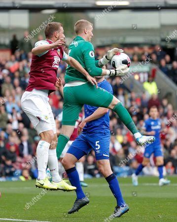 Goalkeeper Jordan Pickford of Everton saves from Chris Wood of Burnley