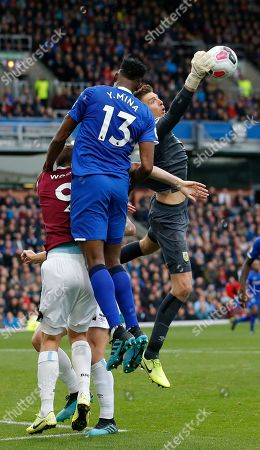 Nick Pope of Burnley saves from Yerry Mina of Everton
