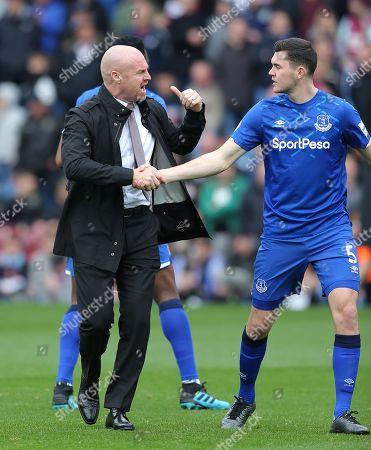 Burnley Manager Sean Dyche greets Michael Keene of Everton at the start of the match