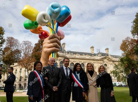 (L-R) Mayor of Paris' 8th district Jeanne d'Hauteserre, Paris Culture advisor Christophe Girard, US artist Jeff Koons, Paris Mayor Anne Hidalgo, former US ambassador in France Jane D. Hartley, US Ambassador in France Jamie McCourt pose in front of Koon's art installation entitled 'Bouquet of Tulips' during its inauguration in Paris, France, 04 October 2019. The art installation was offered to the city of Paris as a tribute to the victims of the 2015 and 2016 terror attacks in France.