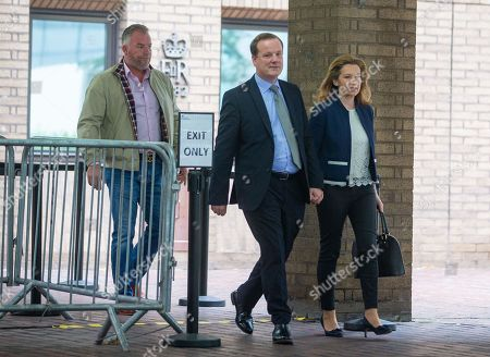 MP for Dover, Charlie Elphicke, leaves Southwark Crown Court with his wife, Natalie Ross. He is charged with three counts of sexual assault. He has entered a plea of not guilty to these charges. He will stand trial next summer. He allegedly kissed and groped a woman in June 2007 and was twice accused of sexually assaulting a second womanin April and May 2016.