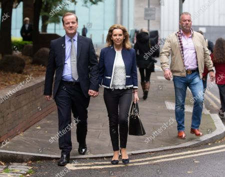 Stock Photo of MP for Dover, Charlie Elphicke, leaves Southwark Crown Court with his wife, Natalie Ross. He is charged with three counts of sexual assault. He has entered a plea of not guilty to these charges. He will stand trial next summer. He allegedly kissed and groped a woman in June 2007 and was twice accused of sexually assaulting a second womanin April and May 2016.