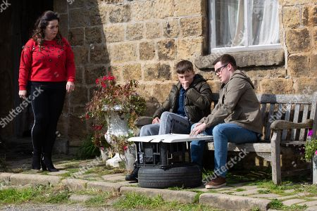Ep 8630 Friday 25th October 2019 Vinny's, as played by Bradley Johnson, worried it's a bad time to leave Emmerdale, but Mandy Dingle's, as played by Lisa Riley, dead-set on them running away, saying it will keep everyone safe but as they talk, we see a stranger watching them from afar.