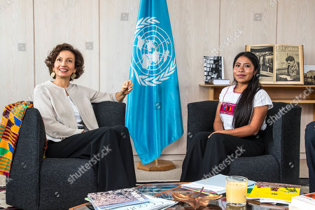 Stock Photo of UNESCO Director-General Audrey Azoulay (L) speaks with the newly appointed UNESCO Goodwill Ambassador, Mexican actress Yalitza Aparicio (R) at the UNESCO headquarters in Paris, France, 04 October 2019.