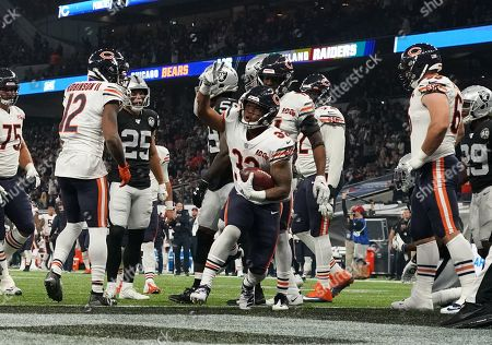 Stock Image of Chicago Bears running back David Montgomery  (32) celebrates scoring a touchdown