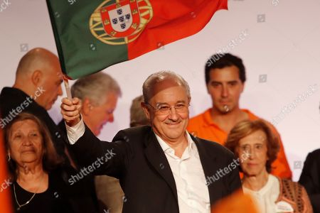 Rui Rio, leader of the Social Democratic Party, center, waves a Portuguese flag during an election campaign rally in Lisbon . Portugal will hold a general election on Oct. 6 in which voters will choose members of the next Portuguese parliament
