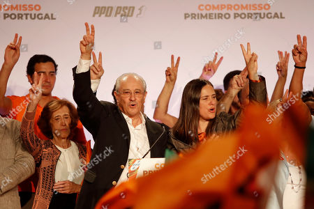 Rui Rio, leader of the Social Democratic Party, center, gestures during an election campaign rally in Lisbon . Portugal will hold a general election on Oct. 6 in which voters will choose members of the next Portuguese parliament