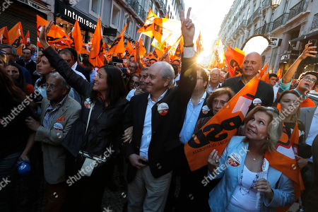 Rui Rio, leader of the Social Democratic Party, center, gestures during an election campaign action in downtown Lisbon . Portugal will hold a general election on Oct. 6 in which voters will choose members of the next Portuguese parliament