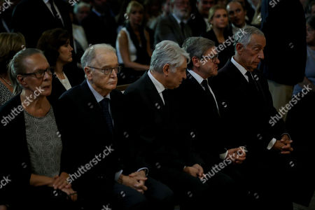 Stock Photo of Portuguese Presidente Marcelo Rebelo de Sousa (R), Portuguese Former President Jorge Sampaio (2L) and his wife Maria Jose Ritta (L), Socialist Party (PS) Jorge Lacao (2R) during the funeral ceremonies of Diogo Freitas do Amaral at the Jeronimos Monastery in Lisbon, Portugal, 4 October 2019. Diogo Freitas do Amaral was a conservative politician who played a leading role in cementing democracy after Portugal?s 1974 Carnation Revolution, former deputy prime-minister, Foreign Minister and later became president of the U.N. General Assembly between 1995 and 1996, has died at 78.