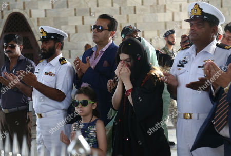 Stock Photo of Mishal Malik (C), wife of Indian Kashmir's separatis leader Yasin Malik, prays as she visits the mausoleum of the founder of Pakistan, Muhammad Ali Jinnah in Karachi, Pakistan, 04 October 2019. Malik said that Indian administered Jammu and Kashmir have been under siege for the five weeks and knew nothing about the well-being of their dears as many of them have been allegedly wounded or killed by Indian force. Normal life has remained paralyzed for the last nearly two months in Kashmir by the government-imposed restrictions and spontaneous shutdown observed by the people against the 05 August move that took away the special status of the Himalayan region.
