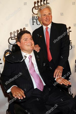 Pro Football Hall of Fame player Nick Buoniconti, right, and his son Marc Buoniconti arrive for the 23rd Annual Great Sports Legends Dinner in New York. Pro Football Hall of Famer Ed Reed and such sports stars as Dwyane Wade, Wladimir Klitschko, Chase Utley, Matt Biondi, Christian Vieri, Amy Van Dyken-Rouen and Meghan Duggan will be honored by The Buoniconti Fund to Cure Paralysis on Monday night, Oct. 7, 2019, at the organization's annual gala. The night really will be dedicated to the late Nick Buoniconti