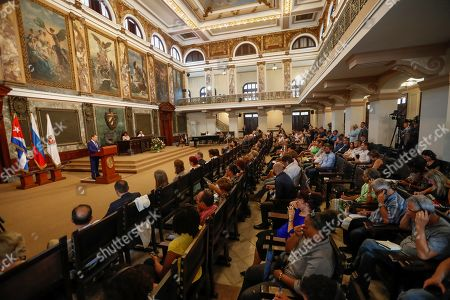 Stock Picture of Russian Prime Minister Dmitri Medvedev (L) delivers a speech during the ceremony where he has been invested with the title of Doctor Honoris Causa in Political Science, in Havana, Cuba, 04 October 2019. Medvedev is on his second day of an official visit to the island.