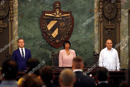 Stock Photo of Russian Prime Minister Dmitri Medvedev (L), the Rector of the University of Havana Miriam Nicado Garcia (C), and the Vice President of the Councils of State and Ministers Roberto Tomas Morales (R), participate in the ceremony where Medvedev received the title of Doctor Honoris Causa in Political Science, in Havana, Cuba, 04 October 2019. Medvedev is on his second day of an official visit to the island.