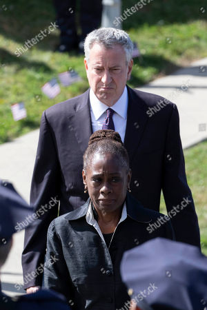 New York Mayor Bill de Blasio and his wife Chirlane McCray leave Church of the Sacred Heart following services for police officer Brian Mulkeen, in Monroe, N.Y. Authorities say Mulkeen was fatally hit Sunday by two police bullets while struggling with an armed man in the Bronx. He is the second New York City officer killed by friendly fire this year