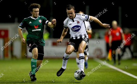 Dundalk vs Derry City. Dundalk's Robbie Benson and Barry McNamee of Derry City