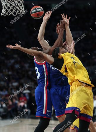 Stock Picture of Barcelona's Brandon Davies  (front) in action against Anadolu Efes' James Anderson during the EuroLeague basketball match between Anadolu Efes and Barcelona in Istanbul, Turkey 04 October 2019.