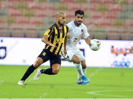 Al-Ittihad player Karim El Ahmadi (L) in action for the ball with Al-Hazem player Hassan Al-Habaib (R) during the Saudi Arabia Professional League soccer match between Al-Ittihad and Al-Hazem at King Abdullah International Stadium AlJawhra, Jeddah, Saudi Arabia, 04 October 2019.