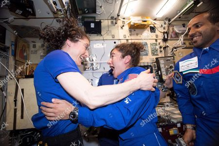 Stock Picture of In this photo made available by NASA astronaut Jessica Meir on Sept. 29, 2019, Christina H. Koch, left, and Meir greet each other after Meir's arrival on the International Space Station. On, NASA announced that the International Space Station's two women will pair up for a spacewalk on Oct. 21 to plug in new batteries
