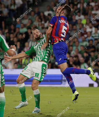 Real Betis' midfielder Sergio Canales (L) in action against Eibar's defender Gonzalo Escalante (R) during the Spanish LaLiga match between Real Betis and SD Eibar at Benito Villamarin stadium in Seville, Andalusia, Spain, 04 October 2019.