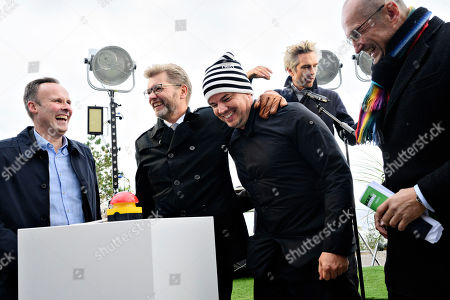 Allan Andersen (L), second chair on the board of ARC and mayor of Taarnby, Headmayor of Copenhagen Frank Jensen (2-L), architect Bjarke Ingels and Christian Herskind (Chairman of the board at Fonden Amager Bakke) push the button that starts the skilift at the official opening of CopenHill, also known as Amager Bakke, a 41,000 m2 waste-to-energy plant in Copenhagen with an urban recreation center in terms of a ski slope, hiking trail and climbing wall on the roof in Copenhagen, Denmark, 04 October 2019. An artificial ski slope and hiking area is built on the roof of the new waste management centre Amager Resource Center in Copenhagen. Amager Bakke is designed by BIG, Bjarke Ingels Group.