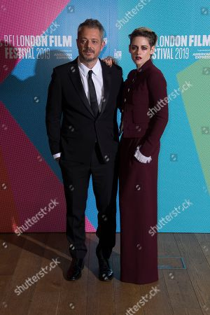 Kristen Stewart, Benedict Andrews. Director Benedict Andrews, left poses for photographers with actress Kristen Stewart, upon arrival at the premiere of the 'Seberg' which is screened as part of the London Film Festival, in central London
