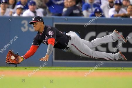 Washington Nationals left fielder Juan Soto catches a fly ball hit by Los Angeles Dodgers' Clayton Kershaw during the third inning in Game 2 of a baseball National League Division Series, in Los Angeles