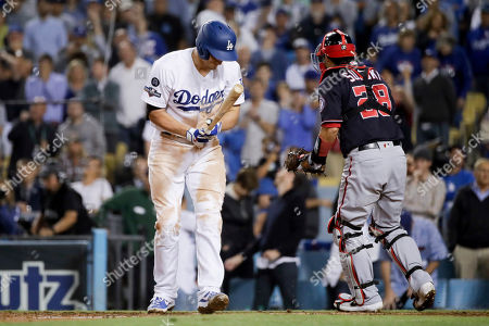Los Angeles Dodgers' Corey Seager reacts after striking out with the bases loaded to end Game 2 of the baseball team's National League Division Series against the Washington Nationals, in Los Angeles