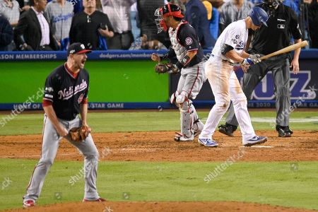 Washington Nationals relief pitcher Daniel Hudson, left, celebrates after Los Angeles Dodgers' Corey Seager struck out to end Game 2 of a baseball National League Division Series, in Los Angeles