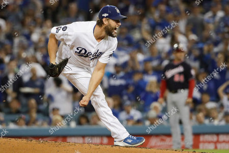 Los Angeles Dodgers starting pitcher Clayton Kershaw throws to a Washington Nationals batter during the second inning in Game 2 of a baseball National League Division Series, in Los Angeles