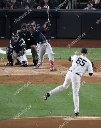 Minnesota Twins batter Jorge Polanco  hits a solo home run off New York Yankees pitcher James Paxton (R) in the top of the first inning of their MLB American League Divsion Series playoff baseball game at Yankee Stadium in the Bronx, New York, USA, 04 October 2019. The winner of the seven game playoff series will go on to face either the Houston Astros or the Tampa Bay Rays in the American League Championship Series.