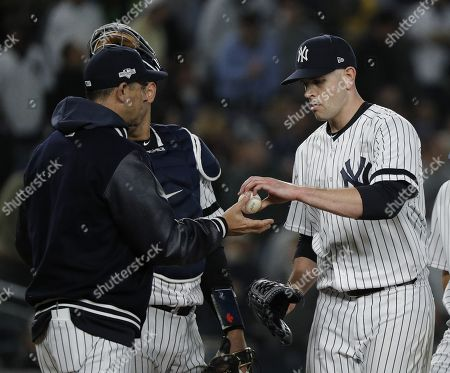New York Yankees pitcher James Paxton (R) is removed from the game by manager Aaron Boone (L) in the top of the fifth inning of their MLB American League Divsion Series playoff baseball game at Yankee Stadium in the Bronx, New York, USA, 04 October 2019. The winner of the seven game playoff series will go on to face either the Houston Astros or the Tampa Bay Rays in the American League Championship Series.