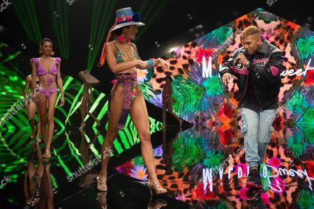Singer Chris Viz and Malena Costa on the catwalk