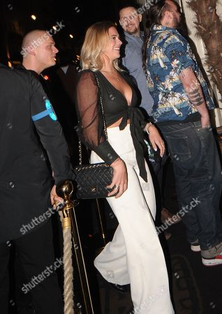 Laura Crane with a mystery man entering Mahiki Anniversary Party after splitting up with Tristan Phipps from Made in Chelsea