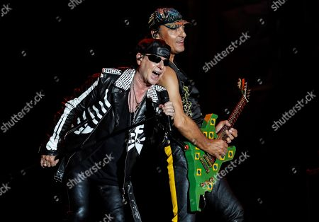 Klaus Meine (L) and Matthias Jabs (R), members of the German band Scorpions, perform on stage during the Rock in Rio 2019 music festival, in Rio de Janeiro, Brazil, 04 October 2019.