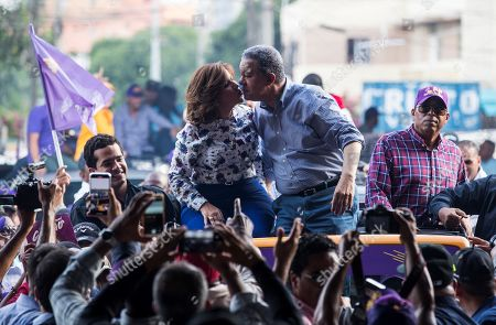 Former Dominican President Leonel Fernandez (R) kisses his wife and current Vice President Margarita Cedeno (L), as they attend a campaign rally prior to the primary elections of the Dominican Liberation Party (PLD), in Santo Domingo, Dominican Republic, 04 October 2019. The Dominican Republic general elections are scheduled to take place 17 May 2020.