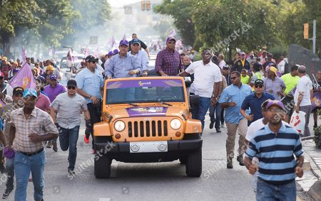 Former Dominican President Leonel Fernandez (C-L) participates in a campaign rally prior to the primary elections of the Dominican Liberation Party (PLD), in Santo Domingo, Dominican Republic, 04 October 2019. The Dominican Republic general elections are scheduled to take place 17 May 2020.