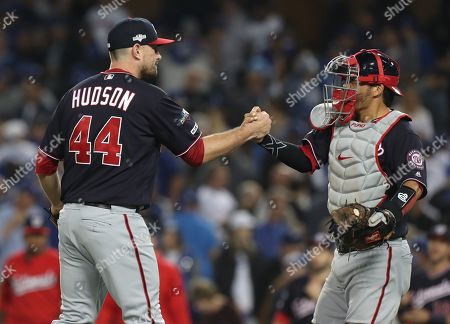 Washington Nationals relief pitcher Daniel Hudson (L) shakes hands with Washington Nationals catcher Kurt Suzuki (R) after striking out Los Angeles Dodgers shortstop Corey Seager with the bases loaded in the bottom of the ninth inning of the MLB National League Division Series playoff baseball game two between the Washington Nationals and the Los Angeles Dodgers at Dodgers Stadium in Los Angeles, California, USA, 04 October 2019.