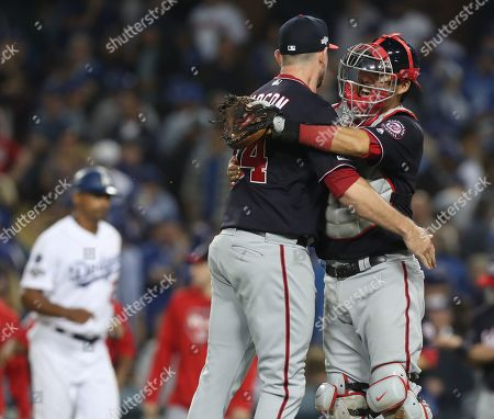 Washington Nationals relief pitcher Daniel Hudson (L) embraces Washington Nationals catcher Kurt Suzuki (R) after striking out Los Angeles Dodgers Corey Seager with the bases loaded in the bottom of the ninth inning of the MLB National League Division Series playoff baseball game two between the Washington Nationals and the Los Angeles Dodgers at Dodgers Stadium in Los Angeles, California, USA, 04 October 2019.
