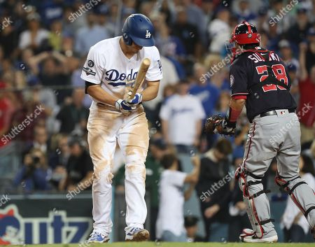Stock Picture of Los Angeles Dodgers shortstop Corey Seager (L) reacts after striking out on a pitch by Washington Nationals relief pitcher Daniel Hudson with the bases loaded as Washington Nationals catcher Kurt Suzuki (R) reacts in the bottom of the ninth inning of the MLB National League Division Series playoff baseball game two between the Washington Nationals and the Los Angeles Dodgers at Dodgers Stadium in Los Angeles, California, USA, 04 October 2019.